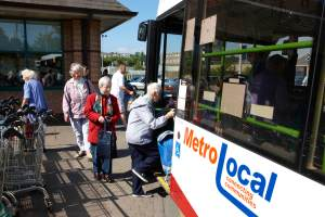 Shoppers boarding the bus