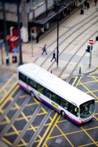 Bus crossing tram line in Manchester
