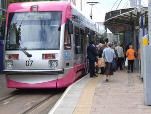 Passengers at Wolverhampton Midland Metro tram stop