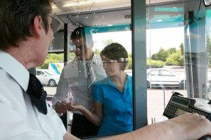 Passengers paying a bus fare