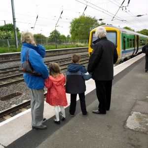 Older people on a station platform with their Grandchildren