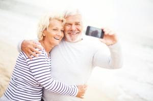 Couple on a beach taking a photo
