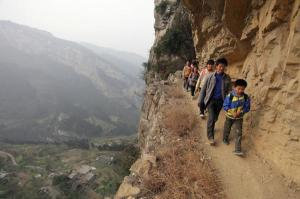 Pupils walking along a cliff-side to a school in China (Atlantic Cities/Reuters)