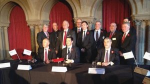 George Osborne  signs the  Greater Manchester deal that ceded the principle of bus franchising outside London. Pic: BBC