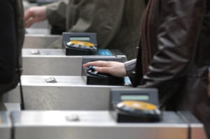 TfL Oyster Card users at ticket barrier (Copyright Transport for London 2005)